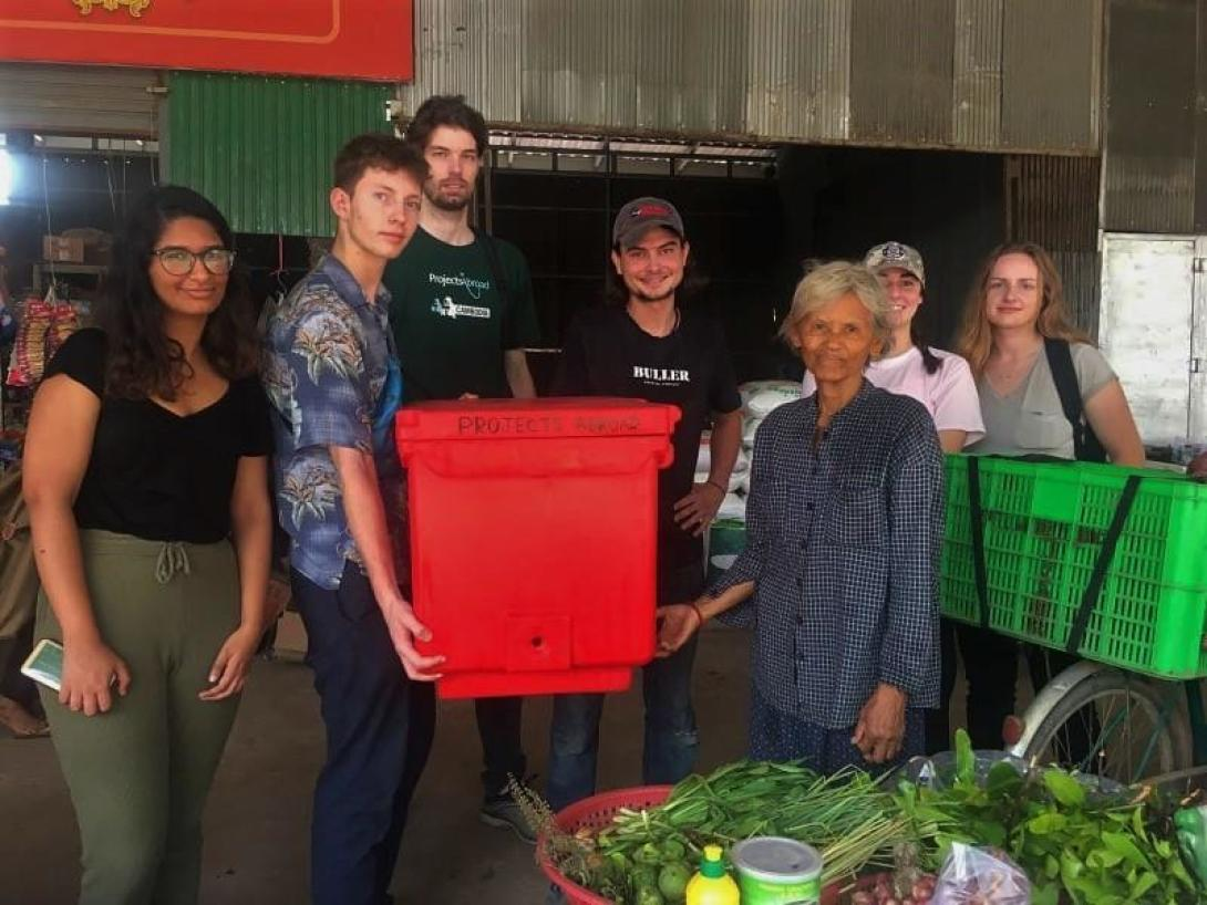 A group of Micro-finance interns abroad in Cambodia donate an ice box to a beneficiary on Silk Island